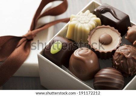 assorted chocolates confectionery in their gift box, close up - stock photo