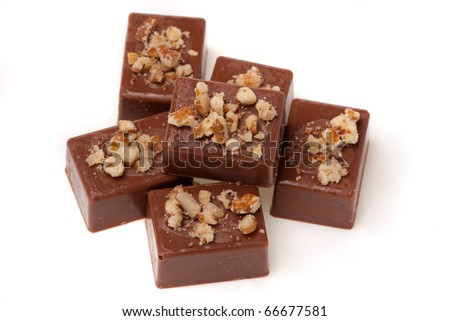 Assorted chocolates isolated in white background. Shallow depth of field. - stock photo
