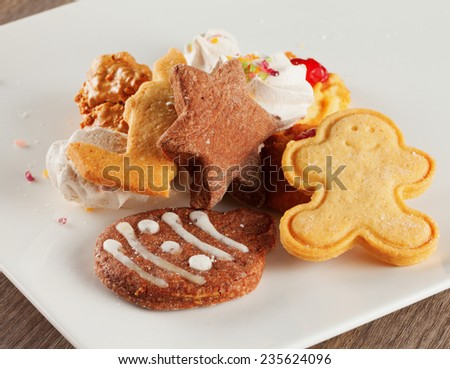 Assorted Christmas biscuits over a white plate - stock photo