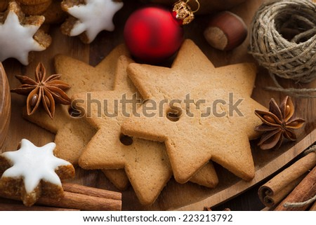 Assorted Christmas cookies, decorations and spices, close-up, horizontal