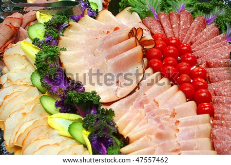 Assorted cold meats on a plate - stock photo