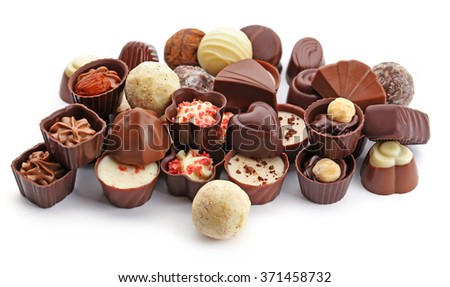 Assorted collection of chocolate candies and sweets, isolated on white - stock photo