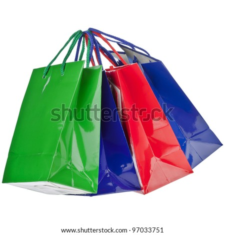 Assorted color shopping bags on a white background - stock photo
