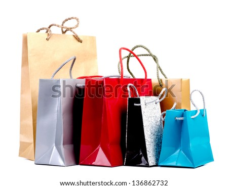 Assorted colored shopping bags on a white background. - stock photo