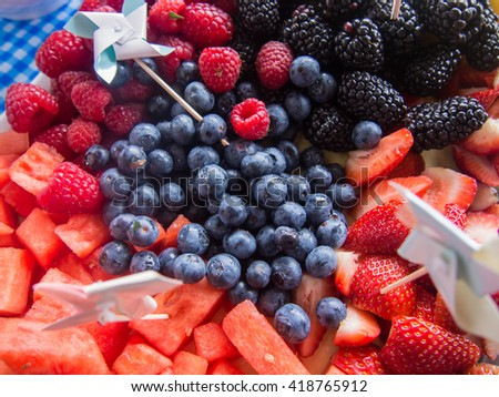Assorted colorful berries on a party plate. - stock photo