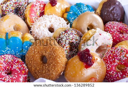 Assorted Colorful Donuts in Box - stock photo