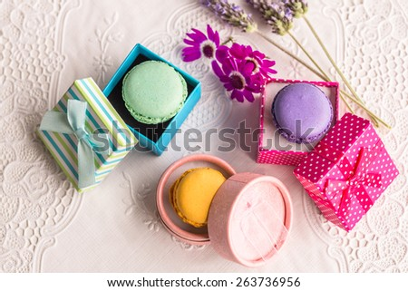 Assorted colorful french macarons food in vintage boxes aerial view Delicious biscuit merinque from France in small gift box with lilac lavender on lace table for bakery business website blog book