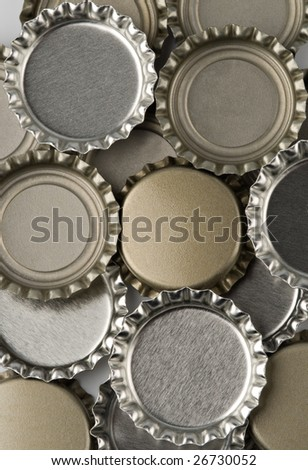 Assorted colors of bottle caps in a pile - stock photo