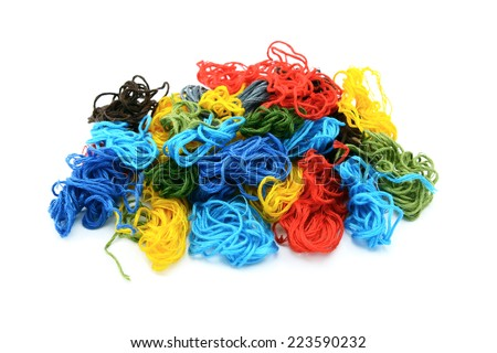 Assorted colourful embroidery threads in a heap, isolated on a white background - stock photo