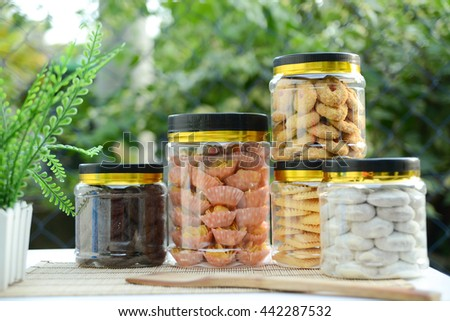 Assorted cookies for celebration. Hari Raya Adilfitri cookies. Slightly de-focused and close up shot. Copy space. - stock photo