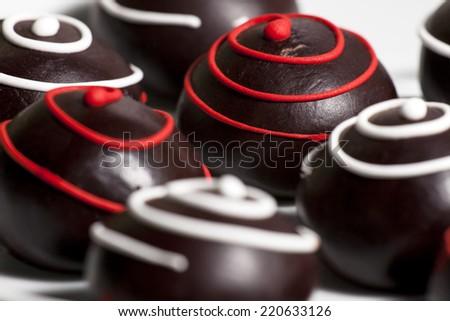 Assorted delicious chocolate praline, candies background - stock photo