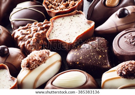 Assorted delicious chocolate pralines background, product photography for patisserie - stock photo