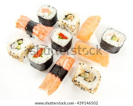 assorted delicious japanese traditional sushi over white