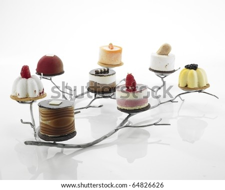 Assorted desserts on tray - stock photo