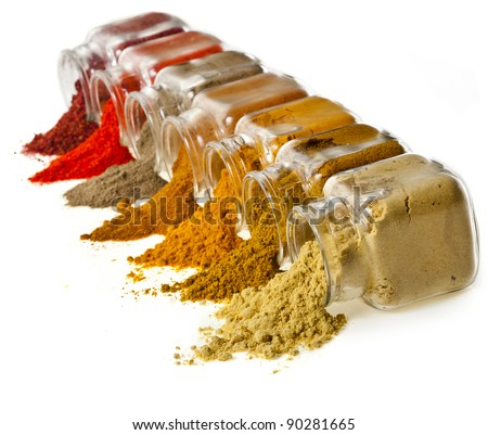 Assorted  different colorful powder spices in glass bottle isolated on white background