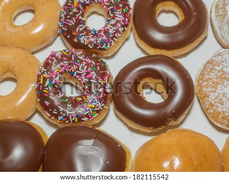 Assorted doughnuts in a white paper box. - stock photo