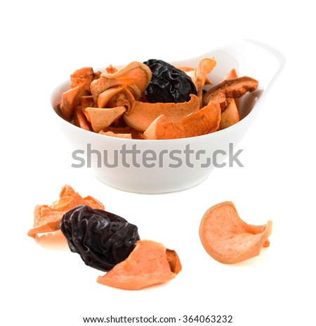Assorted dry fruits on a white background. Isolated photo. - stock photo