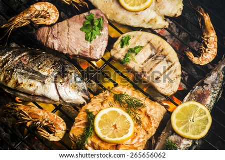 Assorted fish on barbecue grill - stock photo