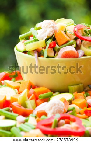 Assorted fresh cut vegetables in a bowl - stock photo