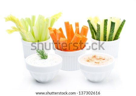 Assorted fresh vegetables (celery, cucumber and carrot) and two yogurt sauce isolated on white background - stock photo