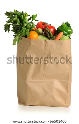 Assorted fruits and vegetables in brown grocery bag isolated over white background - stock photo