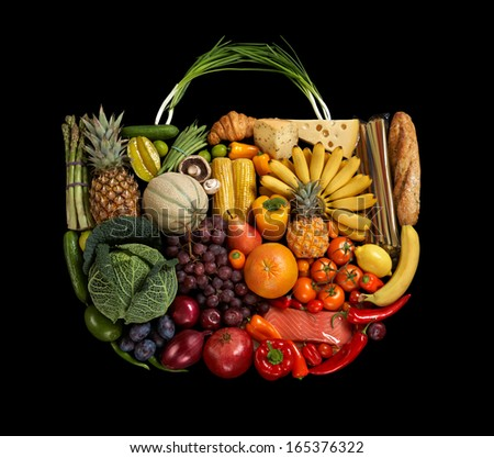 Assorted fruits handbag / studio photography of designer handbag made from different fruits and vegetables - on black background  - stock photo