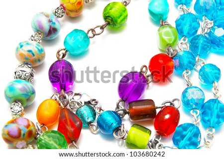 assorted glass beads, on white - stock photo