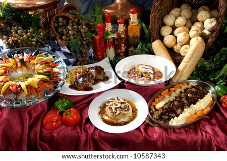 Assorted gourmet dishes arranged on a table - stock photo