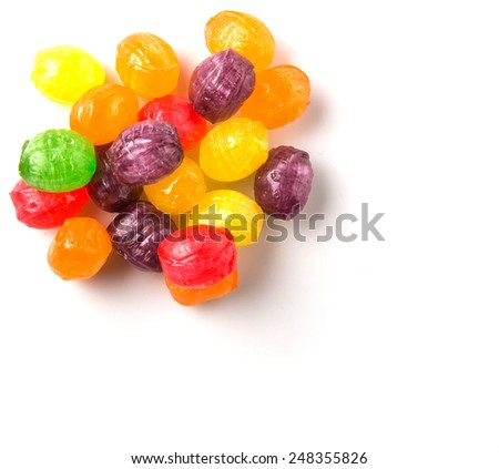 Assorted hard candy sweets over white background - stock photo