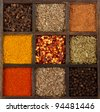 assorted herbs and spices in a decorative box, cloves, nutmeg, curry, chili powder, crushed chillies, dill seed, thyme, peppercorn, anise - stock photo