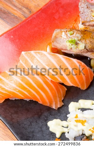 Assorted japanese sushi on a wooden plate