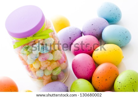 Assorted jelly beans in pastel colors with darker spots.
