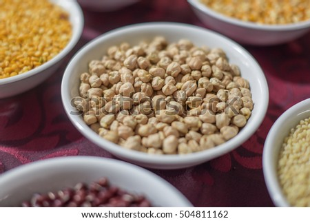 assorted lentil and beans on brown cloth background. selective focus. tone image