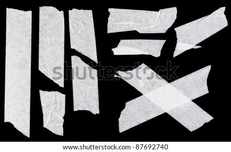 Assorted masking tape stripes isolated on black - stock photo
