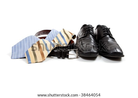 assorted men's clothing accessories including shoes, ties, belt
