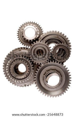 Assorted metal cog gears on white background - stock photo