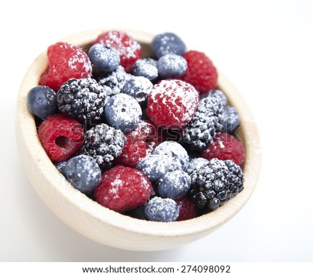 Assorted mixed berries in a bowl isolated on white - stock photo