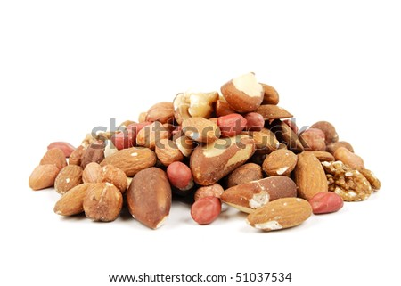 Assorted mixed nuts on a reflective white background - stock photo