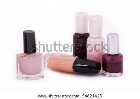 Assorted nail polish on white - stock photo