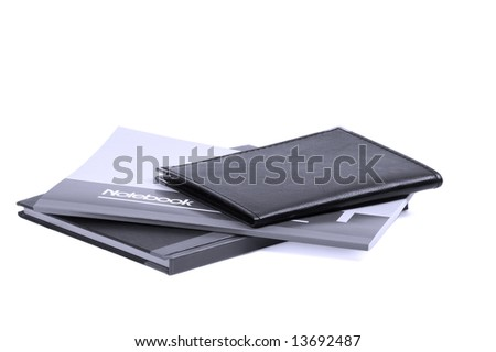 assorted notebooks flat piled on white background,blue filter - stock photo