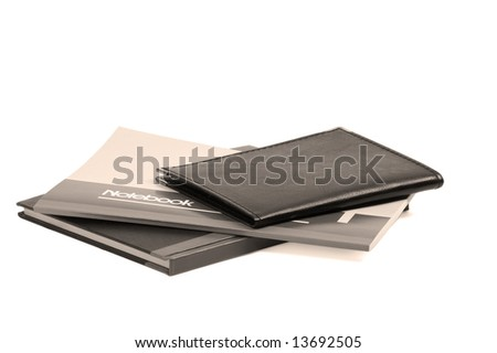 assorted notebooks flat piled on white background,sepia filter - stock photo