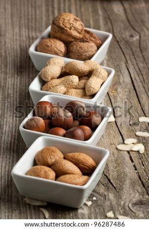 Assorted nuts almond, hazelnut, walnut and peanut - stock photo