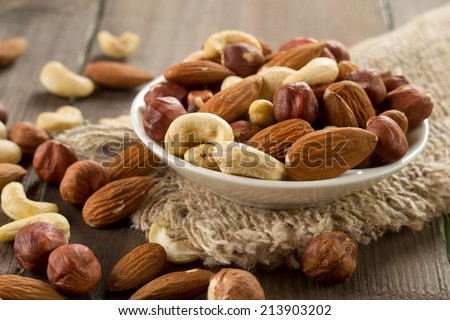 Assorted nuts (almonds, hazelnuts, cashews, peanuts) - stock photo