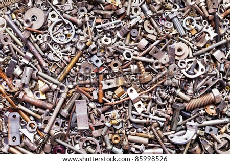Assorted nuts and bolts background - stock photo
