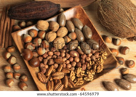 Assorted nuts in wooden bowl. - stock photo