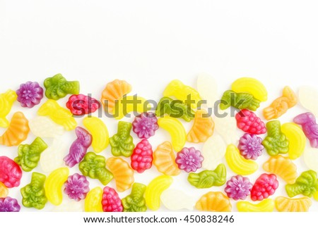 Assorted of colourful fruit jelly candies, top view - stock photo