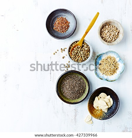 Assorted Oilseeds in Ceramic Dishes - stock photo