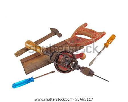Assorted old hand tools on a plain white background.
