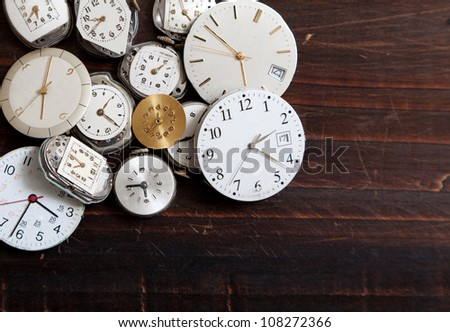 Assorted old, wrist watch faces creating a background - stock photo