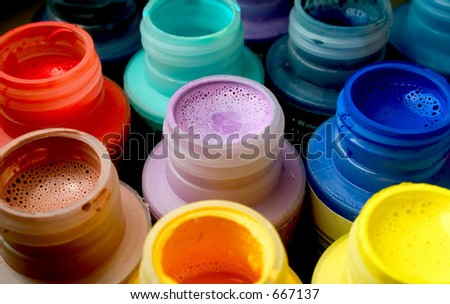Assorted paint bottles - stock photo